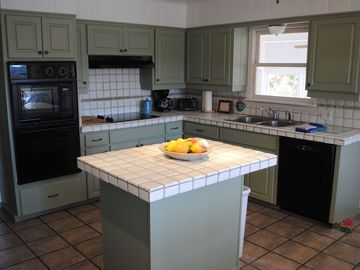 Large fully-equipped Kitchen with island for food preparation and serving
