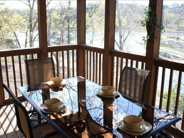Enjoy the lake front view while dining or relaxing on the screening in deck.