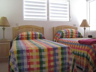 Montserrat villa photo - Guest Bedroom plus ensuite - Triple Aspect views to Garden, Mountains and Pool