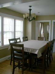 Harpers Ferry house photo - dining room with wood table with seating for 8