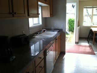 Portland house photo - Kitchen counter and sink and out through door into backyard.