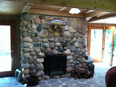 Custom build, hand-laid fieldstone fireplace that burns real wood.