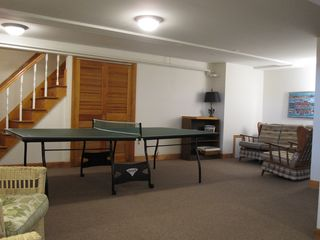 Pocasset house photo - Lower level ping pong table and one of two seating areas