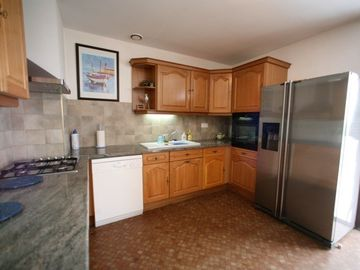 kitchen with American fridge