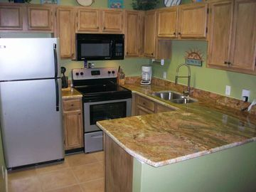 Newly remodeled kitchen with granite countertops.