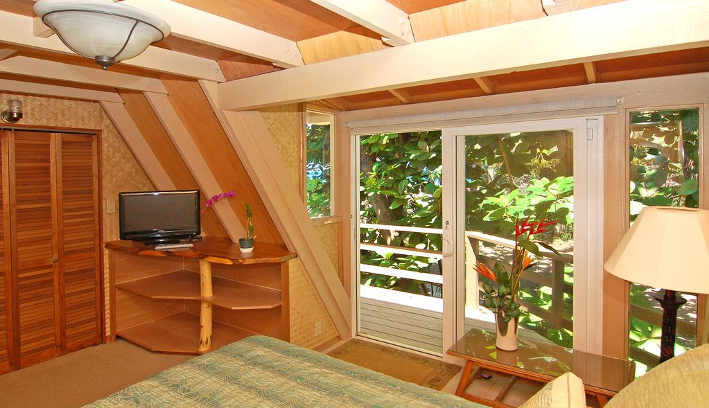 The Queen Bedroom Opens Onto The Wraparound Decks And Also Views The Ocean.