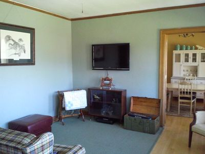 The living room includes a large screen TV and plenty of room to lounge.