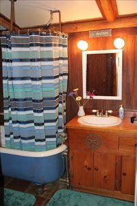 Bathroom with luxurious antique clawfoot soaking tub.