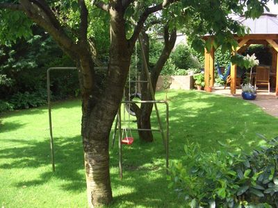 Garden with climbing frame and swing