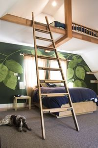 Enjoy sleeping under the hops (hand-painted) on a comfy Tempurpedic-topped qn bd
