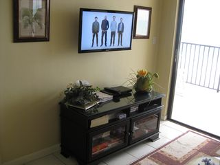 Seawinds condo photo - New swivel flat screen TV with DVD player and board games in console
