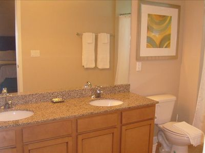 Master bathroom with granite, double vanity, and large shower/tub.