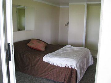 Bdrm 3 w/ 1/2 bath. Downstairs, private entrance, no direct access to main house