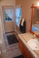 Russian River house photo - Spacious Master Bathroom w/private Deck access and a jetted jacuzzi tub.
