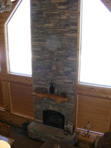 Stacked Stone Fireplace to warm up,gather and entertain