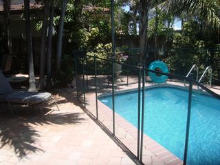 Fort Lauderdale house photo - Private heated pool with fully removable child safety fence.