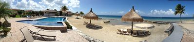 Panoramic view of the pool and beach area in front of Cozumel Sol