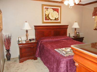 Master Bed Room - Queen size, flat screen TV, & large walk-in closet.