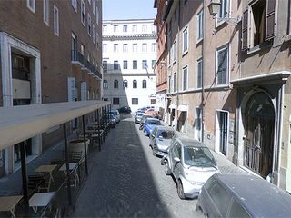 Piazza di Spagna apartment photo - the Street, on the right the building, on the left the wine bar restaurant Gusto