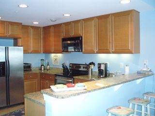 Vacation Homes in Ocean City condo photo - Kitchen with counter seating