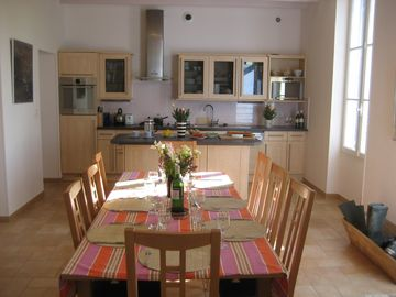 The kitchen seem from over the dining table