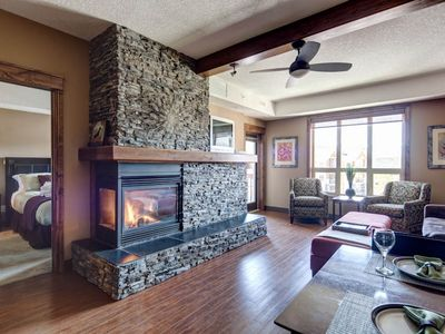 Rundlestone's main living area, featuring a double sided gas fireplace