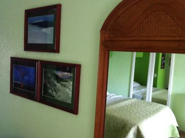 Photographs appear frequently on the walls.