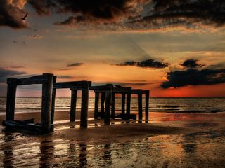 Cape May house photo - .a dramatic sunset over an old pier