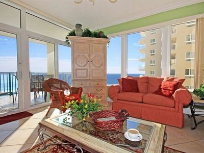 Platinum Rated Condo's Living Room has Expansive Gulf Views. Flat Panel TV and DVD in Entertainment Center.