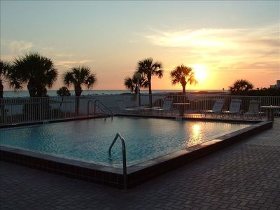 Sunset from the swimming pool over the beautiful beach and Gulf of Mexico