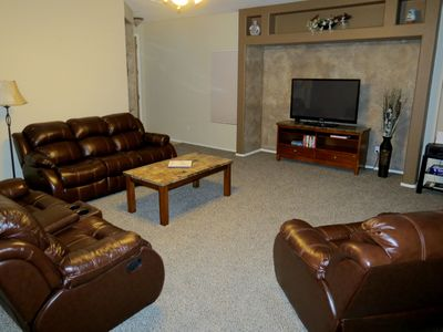 "Family room with leather reclining furniture and 50"" Samsung Smart HDTV"