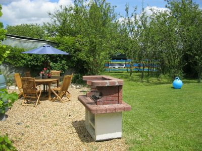 BBQ and seating area.