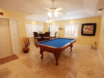 Game Room has bar, pool table with ping pong table top, domino table