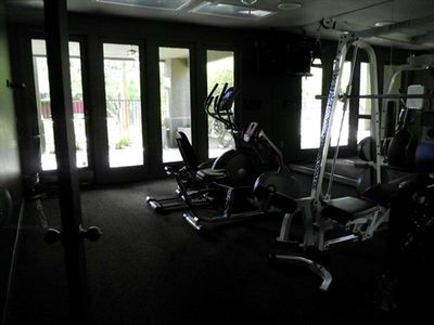 Indoor Fitness Center available for your stay. Photos is dark because of glass.