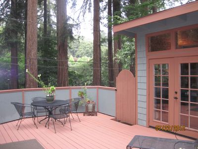 Large deck with beauty all around. Bunk house pictured.