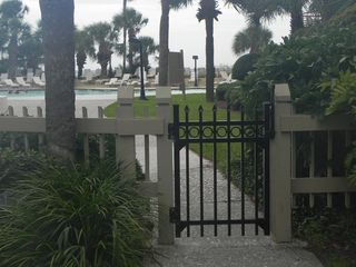 Palmetto Dunes condo photo - Safety gate entrance to the pool. All kids must be accompanied by an adult.
