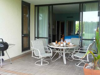 Humacao condo photo - Terrace with door to living room on left.