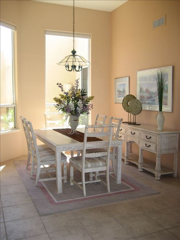 Formal dining area that looks out to front enclosed patio with gas fireplace