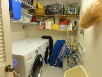 Laundry room w/new w/d. Note beach equipment. Even more chairs on lanai.