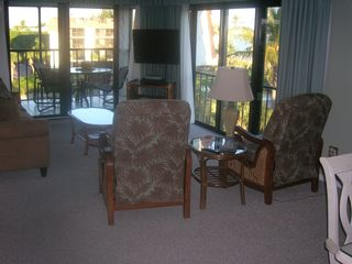 Sanibel Island condo photo - Living Room with wall of windows and flat screen TV