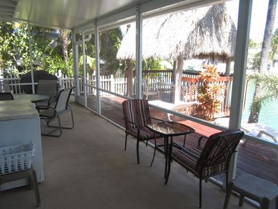 Screened Porch with Patio set overlooking the canal.