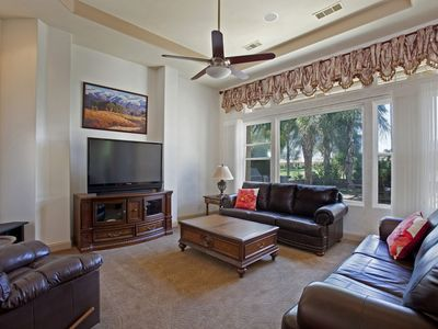 Casual living room with TV/DVD/Sound System & backyard/golf course view