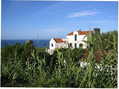 Sao Miguel Island house rental - view of house from a distance with seascape in the background
