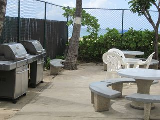 Makaha condo photo - The Barbeque Area with new Gas Grills right on the Beach!