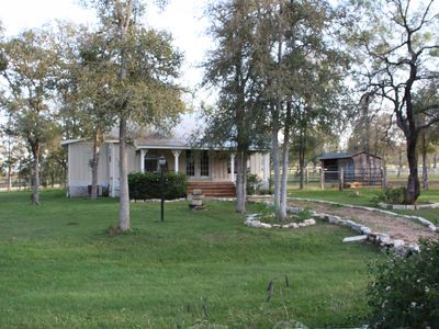 Ranch House from side showing Horse Barn