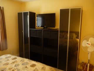 Ormond-by-the-Sea condo photo - Wall unit with lots of storage in Master Bedroom
