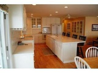 Gilford house photo - Spacious kitchen with breakfast bar and eat-in kitchen table.