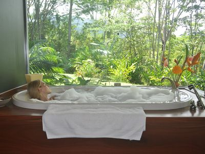 Dulce Suenos spa suite bathroom includes a jacuzzi spa and mountain views.