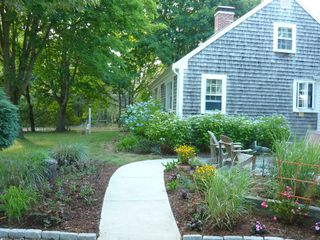 Chatham house photo - Front walkway and side view of home (front yard in distance)