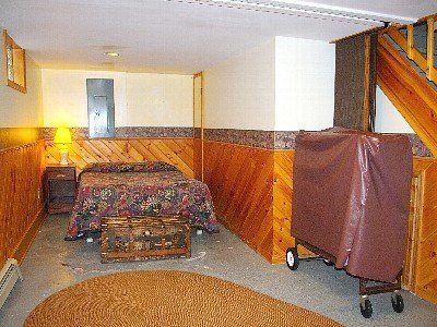 West end of lower level. A double bed with a curtain for privacy.
